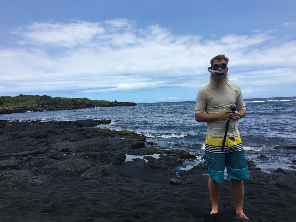 Snorking man at Punalu'u Black Sand Beach