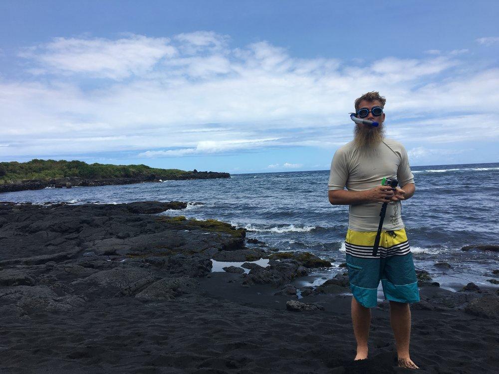 Snorking man at  Punalu'u Black Sand Beach