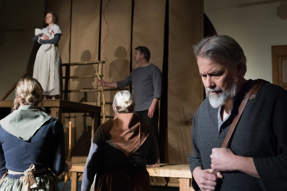 Chillingworth (Rob Andersen) watches as Hester (Leah Christine) is on scaffold.
