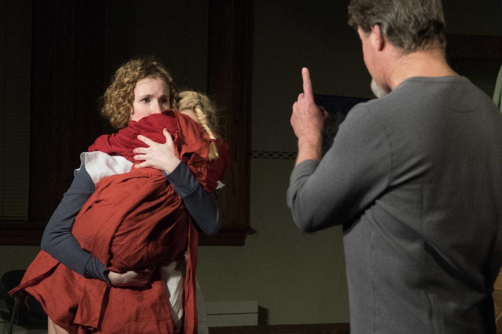Hester (Leah Christine) being warned by Governor Bellingham (Robb Krueger)