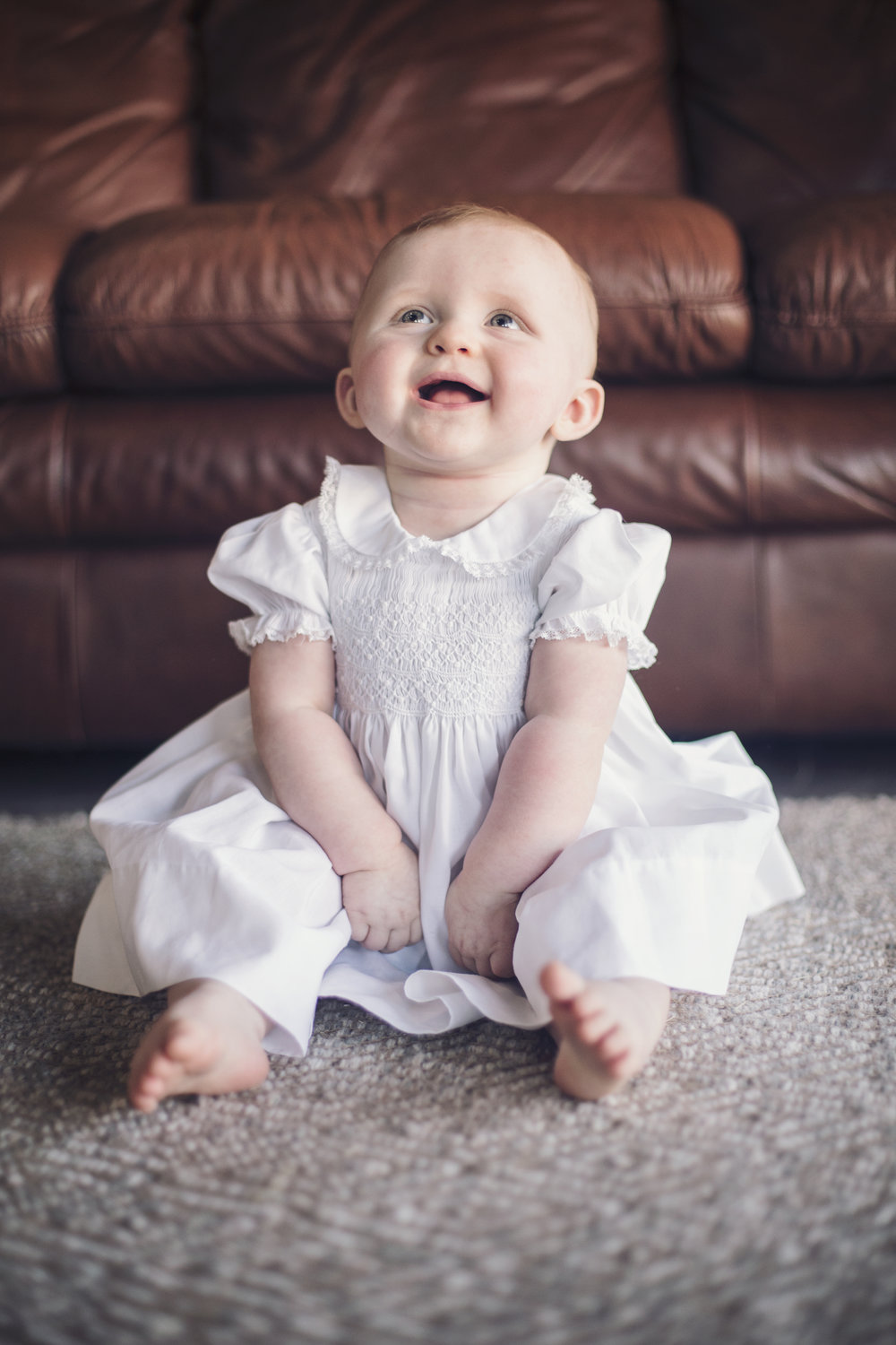 Hannah is so cute in this classic baby white dress. She looks just like a doll :)