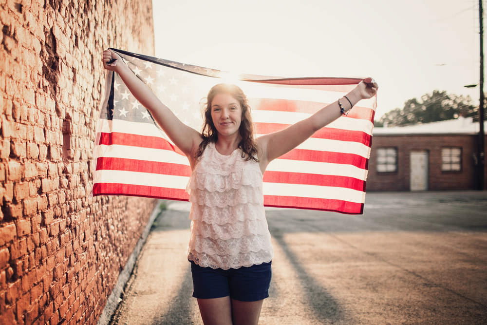 Annalise had the wonderful idea of incorporating her American flag into her portrait session. I'm so glad she did because I think we got some really cool stuff :)