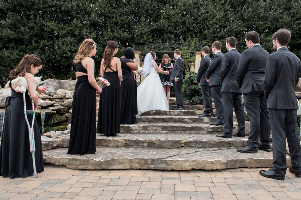 Do you think this scene wasn't planned? Even the bridesmaid on crutches had to be choreographed. These things don't just arrange themselves.