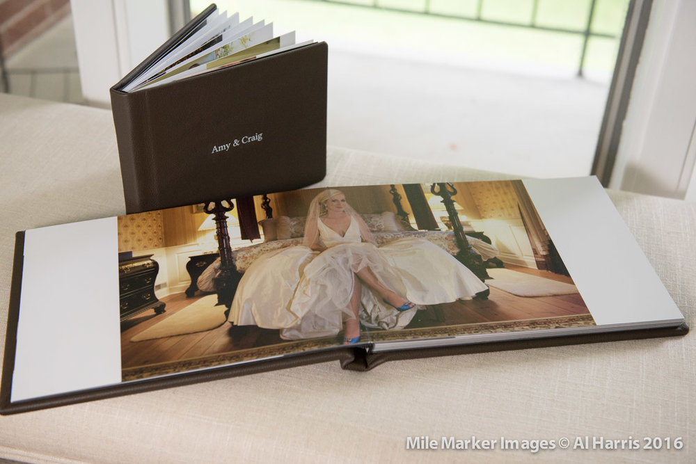 Sample of our wedding albums - leather, archival paper, and all lay flat pages.