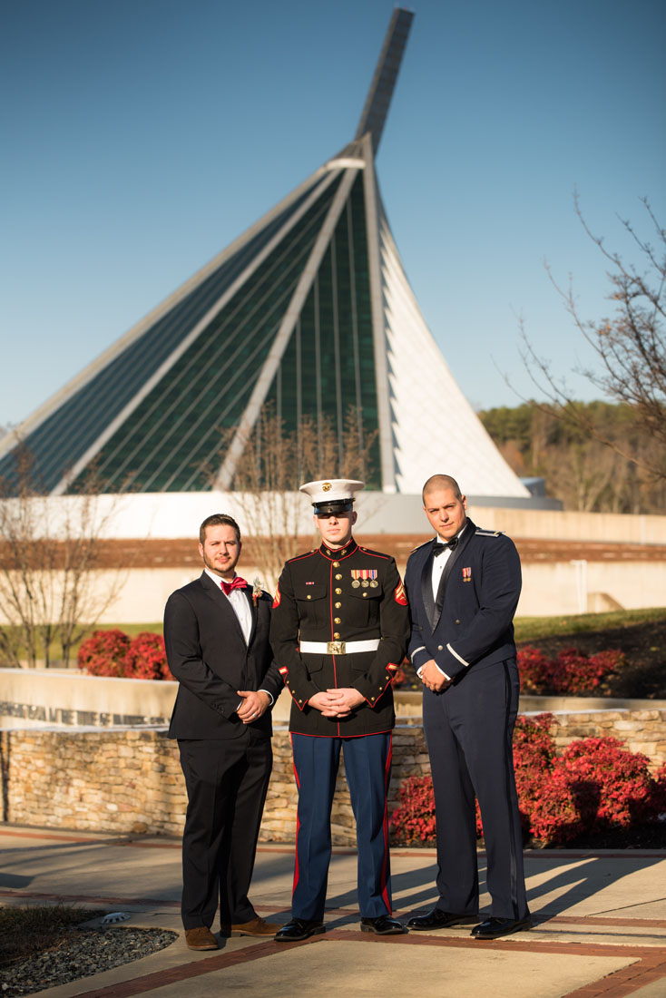 Ben (center) and his boys with the National Museum of the Marines in the background