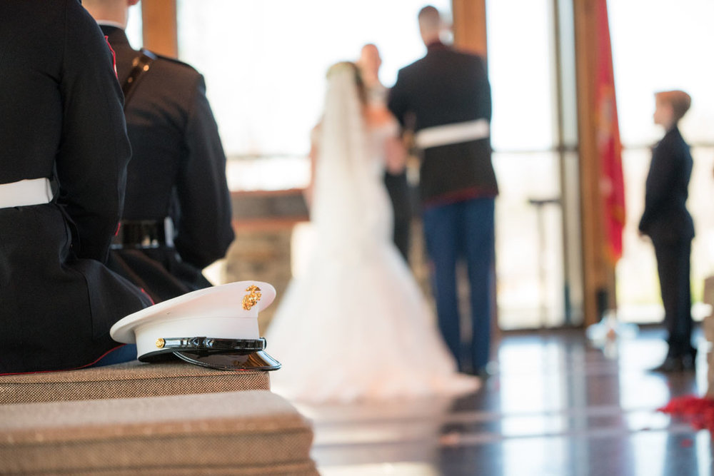 Love this shot of one the marine's cover! Military weddings are very special.
