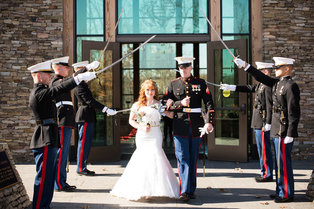 As the couple passed, each Marine slowly lowered his saber to close the path behind them.