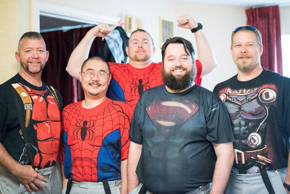 Paul and groomsmen in super hero shirts.