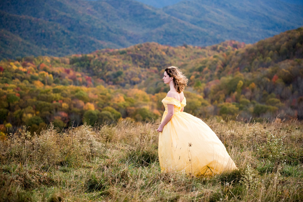 bride in flowing yellow dress with gorgeous fall color all around on the smoky mountains
