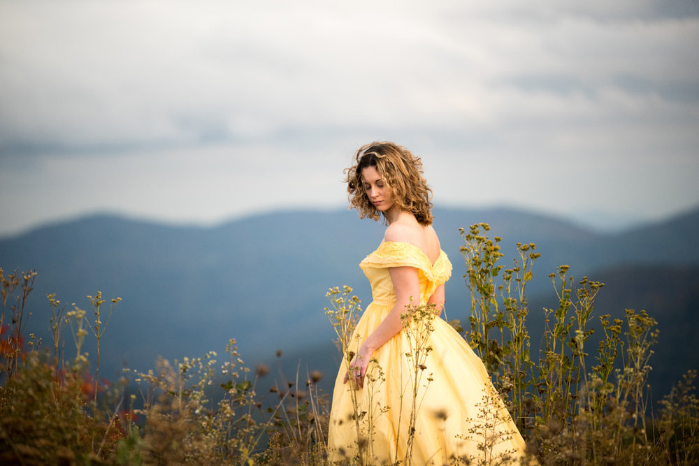 bride in yellow dress in tall grass