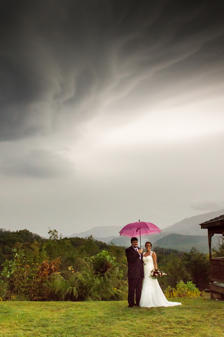 Bride and groom stand below the remnant of Hurricane Nate. This was the only moment of the day when it wasn't raining.
