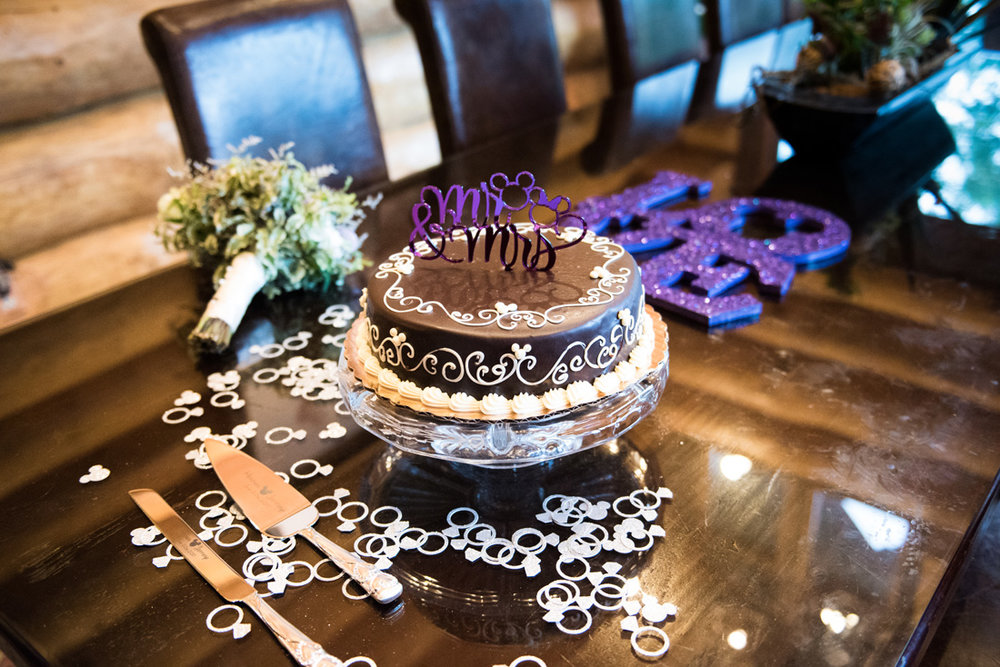 We love the elegant wedding cake with Mickey Mouse bling scattered about.
