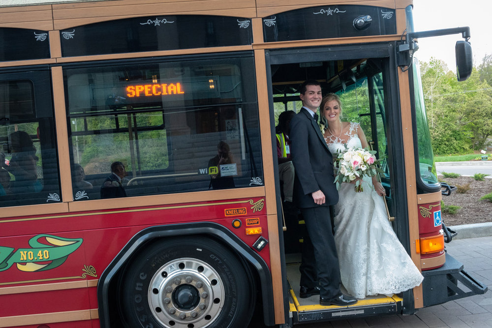 Tyler & Cassidy board a Knoxville trolley to head to the reception.