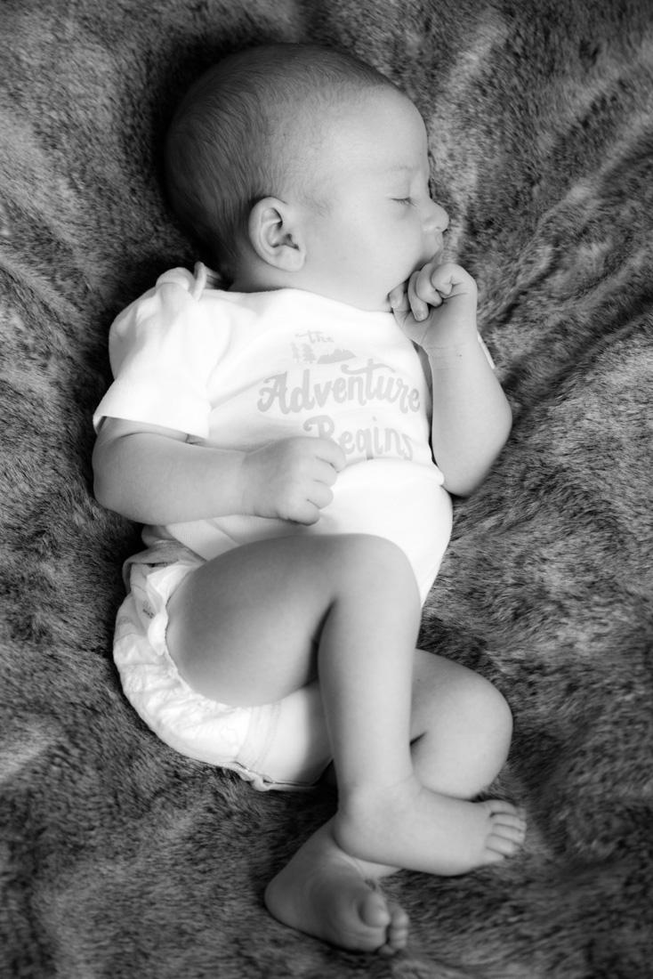 newborn photography of baby on fur blanket