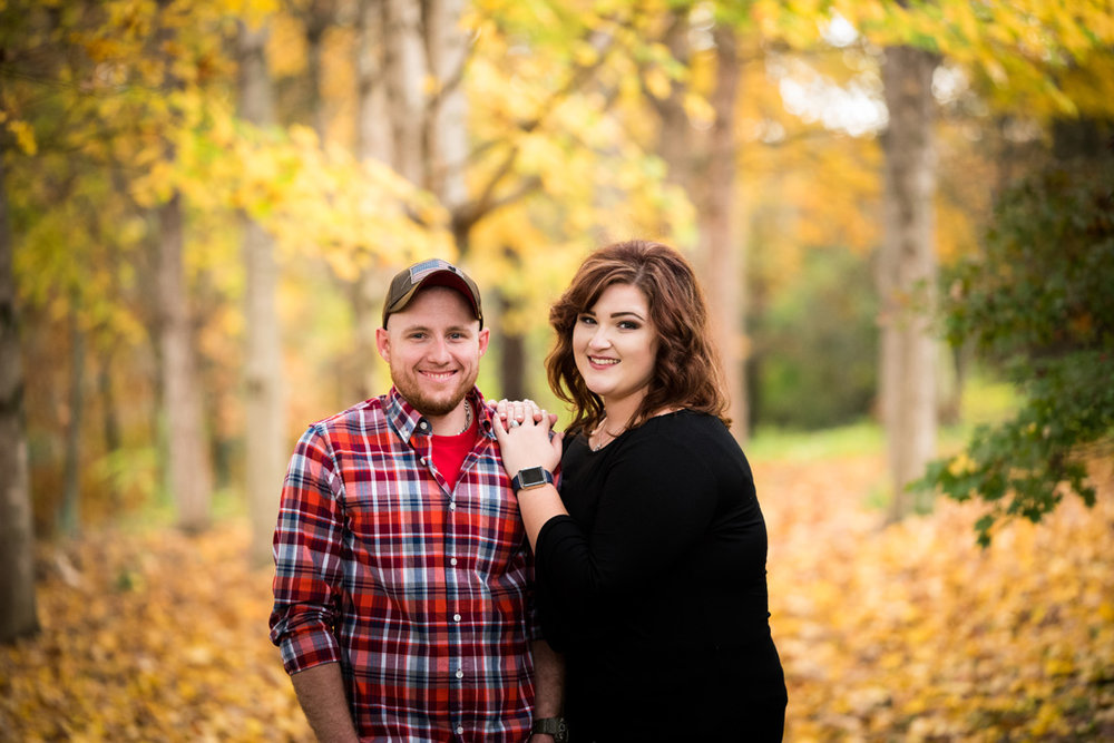 engagement photo of engaged couple in fall color