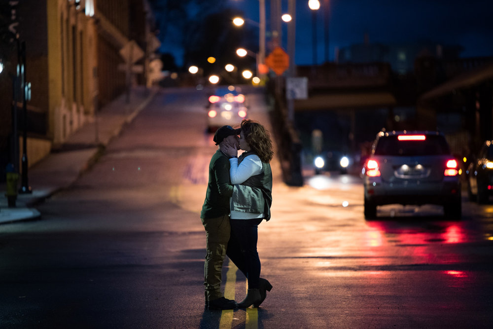 engagement photo of engaged couple in an empty night street