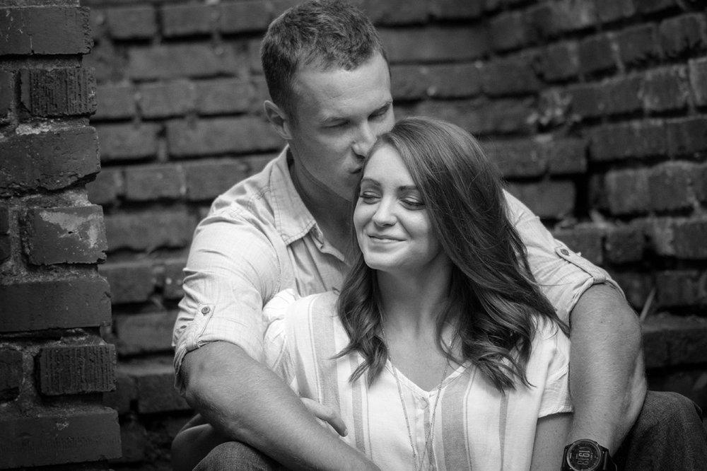 engagement photo of engaged couple sitting on steps