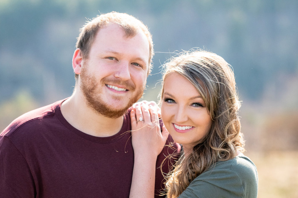 engagement photo of engaged couple holding onto one another