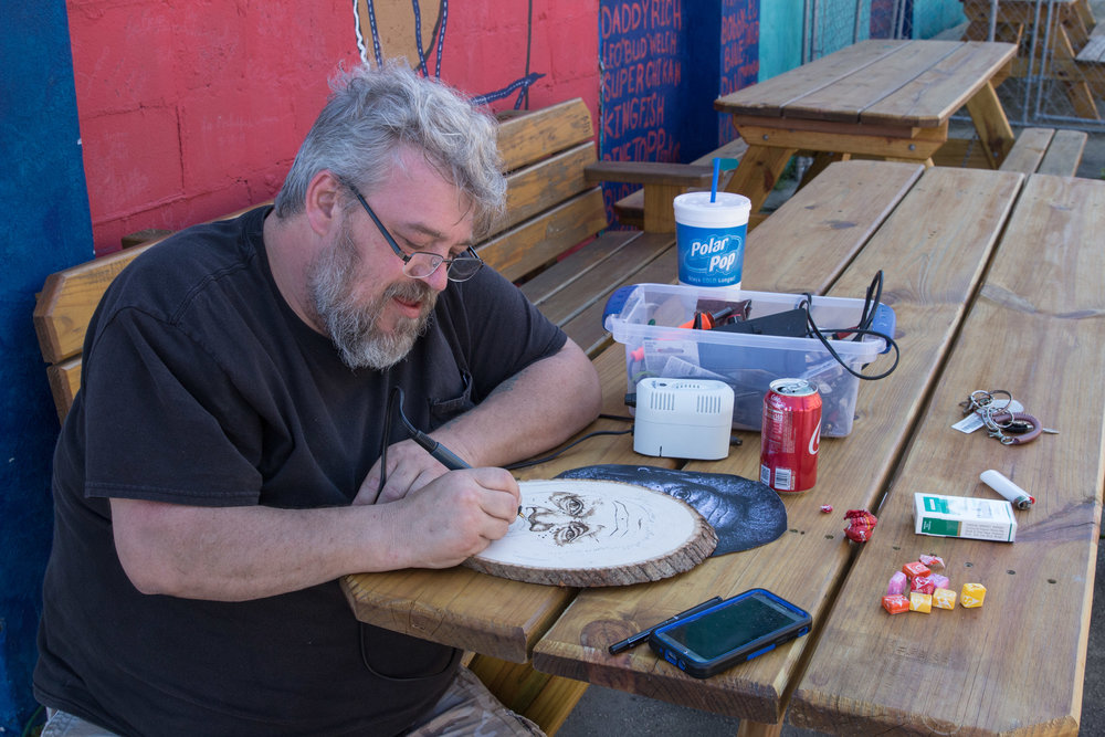 """Bryan Weems, """"The Woodcarver""""; working on a portrait of Morgan Freeman."""