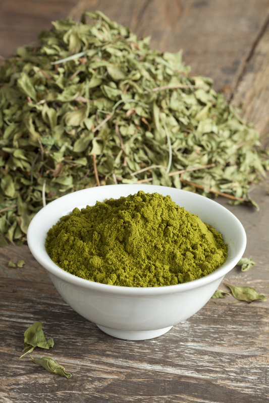 Henna leaves are dried and ground into powder for use as a hair dye and skin stain.