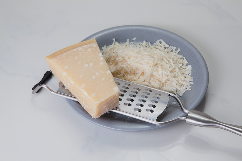 After blending all other ingredients in a food processor or mortar/pestle, stir in shredded cheese.