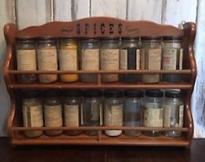 My grandmother had the same shelves and matching jars sitting directly over her stove. Convenient for cooking, but detrimental for the herbs.