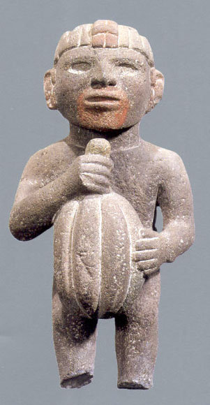 Aztec sculpture holding a cacao pod (Attribution:  http://www.latinamericanstudies.org/aztec-figures.htm )