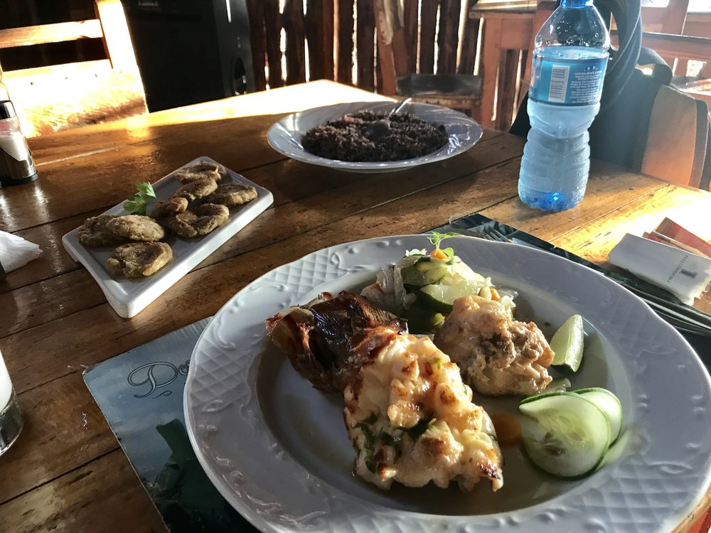 Enjoying some grilled lobster, tostones and rice and beans during my last night in Havana.