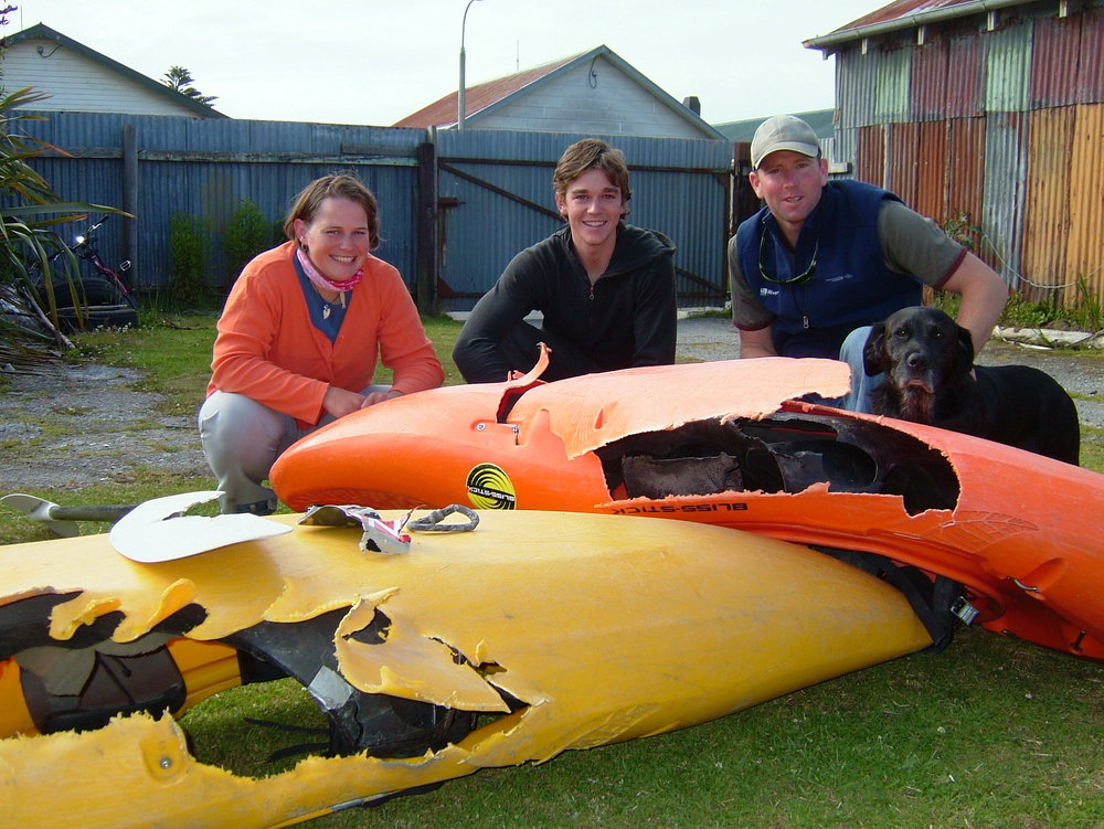 Irene, Ricky, Jett and I. This is the damage the tail rotor did when it sliced through the boats. Lying on top is a carabiner that was on my life jacket in the machine, contorted by the heat. Also a piece of the fuselage.