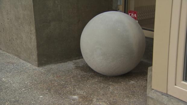 Concrete balls block alcoves in Vancouver. Image source:  Dillon Hodgin, CBC