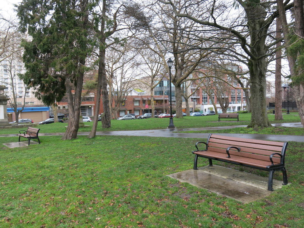 "Benches in Pioneer Square use centre ""arm rests"" to keep people from lying down."
