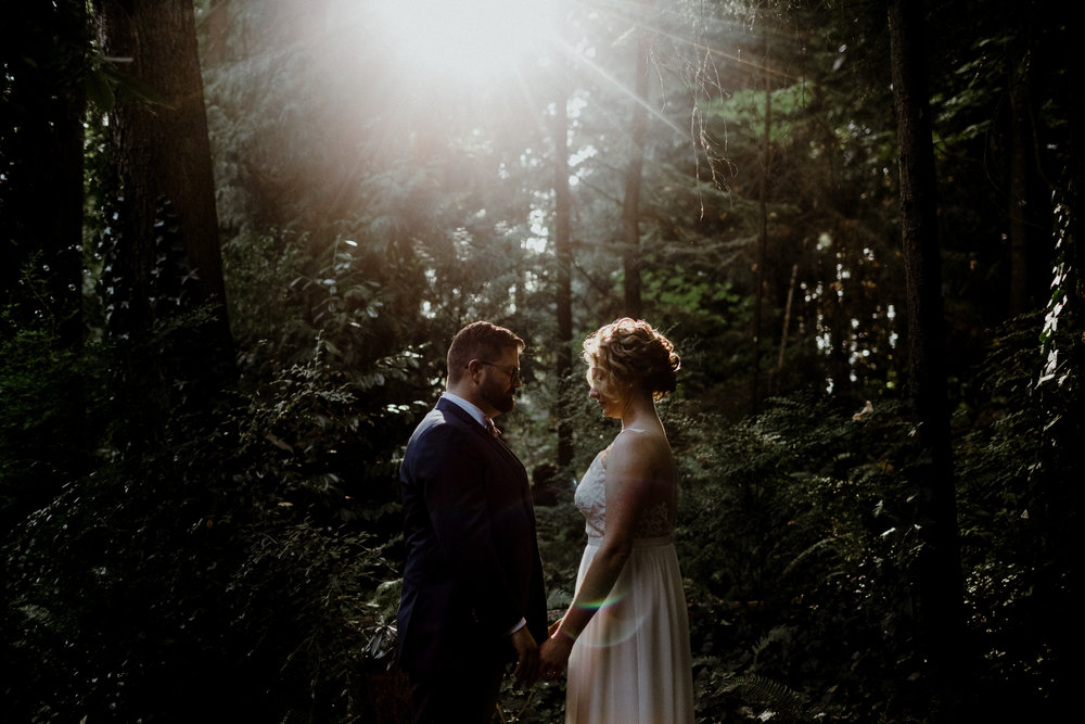 A romantic wedding photo at a forest in West Vancouver