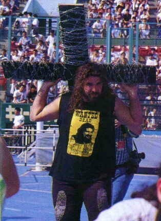 mick_foley_carrying_a_barbed_wire_cross_at_iwa_japan_king_of_the_death_match__Lj8M20XH.jpg