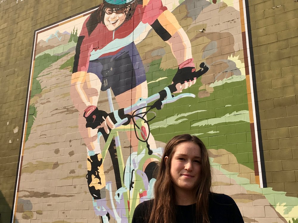 Léa McCroy, 17, stands in front of a Canmore mural in memory of her mom, Isabelle Dubé, who was killed in a grizzly bear attack in June 2005.