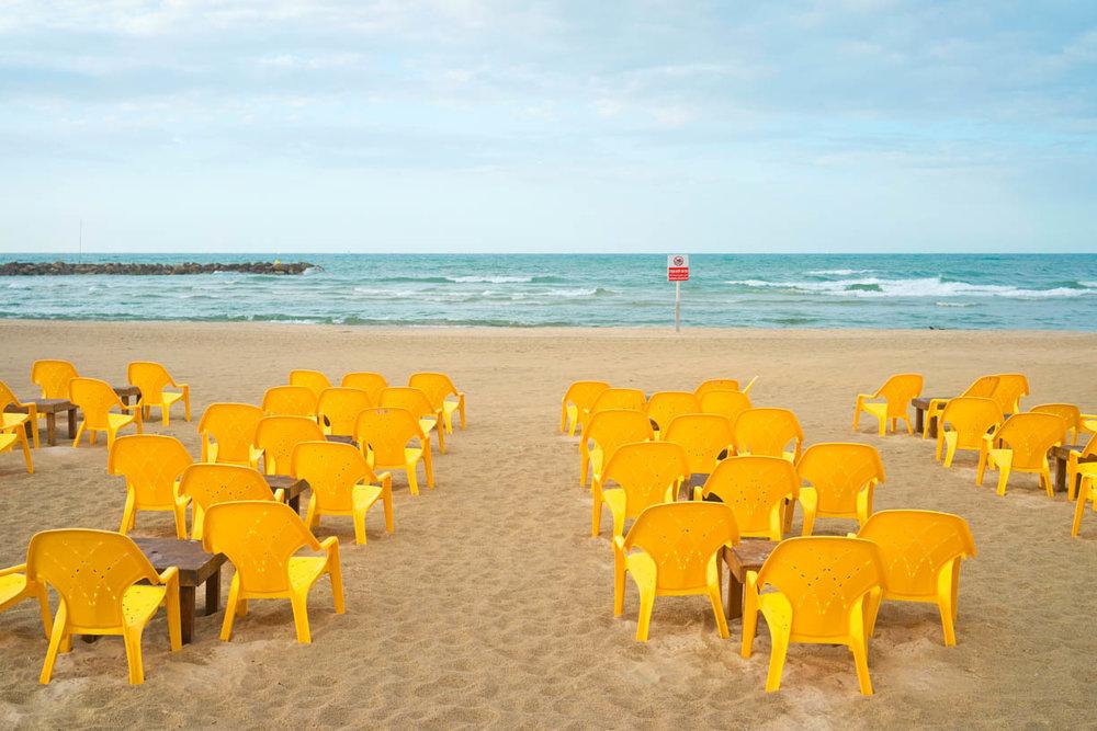 Ido Biran Tel Aviv beach, yellow plastic chairs