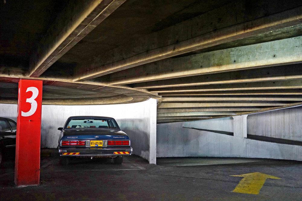 Tel Aviv architecture, blue Chevrolet in an underground parking
