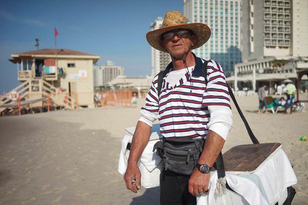 Tel Aviv beach, people in the city, ice cream vendor