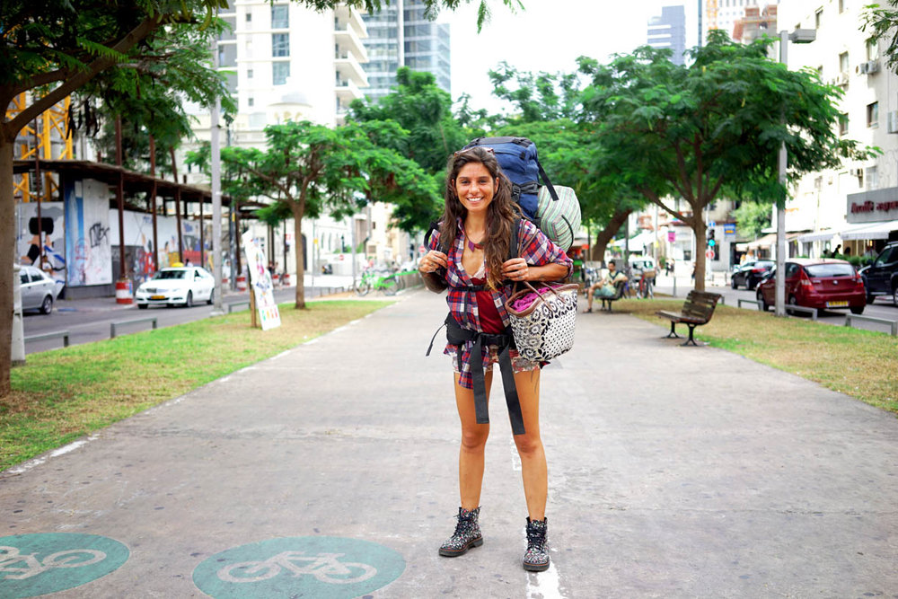 Tel Aviv, people in the city, girl with a backpack