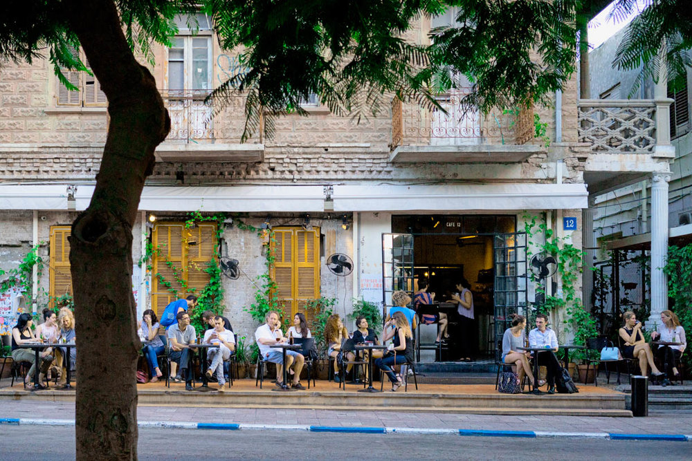 Tel Aviv cafe, people in the city, sidewalk tables