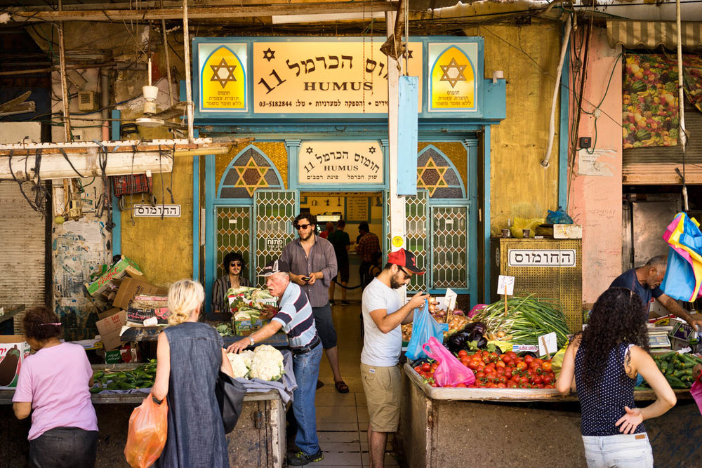 Tel Aviv Ha-Carmel market, people in the city, vegetables, hummus hacarmel