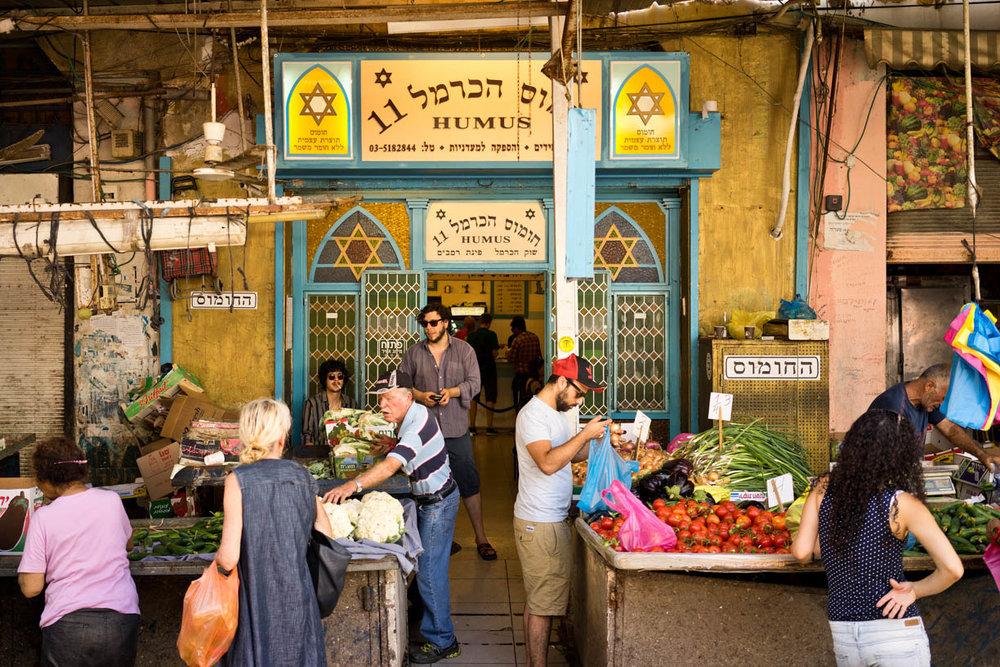 Tel Aviv Ha-Carmel market, people in the city, vegetables, hummus hacarmel