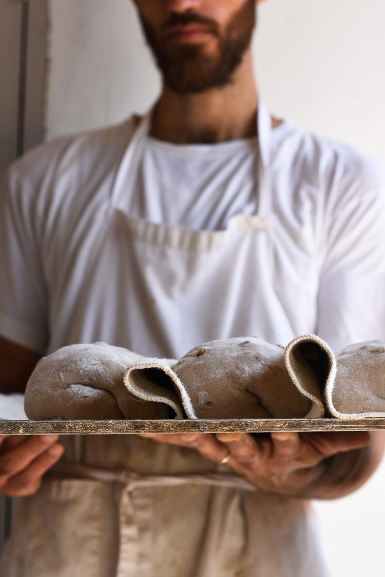 Roman Giler, Ovdey Adama, bakery, sourdough, bakers, Beit Hashita, kneading dough, bread maker, loaves on a tray