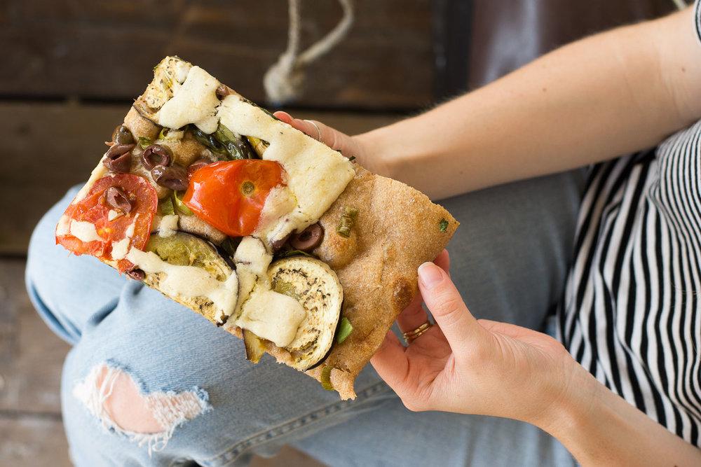 Ovdey Adama, bakery, sourdough, Beit Hashita, bread, focaccia bread, focaccia slice, girl holding bread