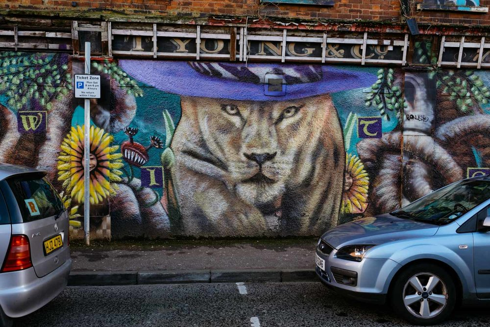 Narnia's Aslan as a pimp, on the side of an old brothel.