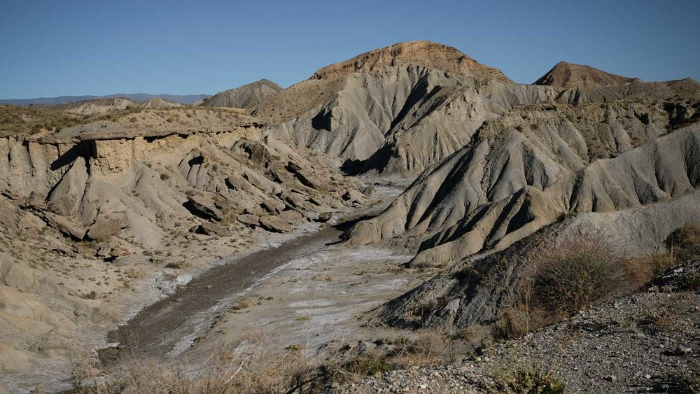 "The arid Tabernas—the only ""desert"" in Europe—with its characteristic badlands and dry riverbeds called ramblas."