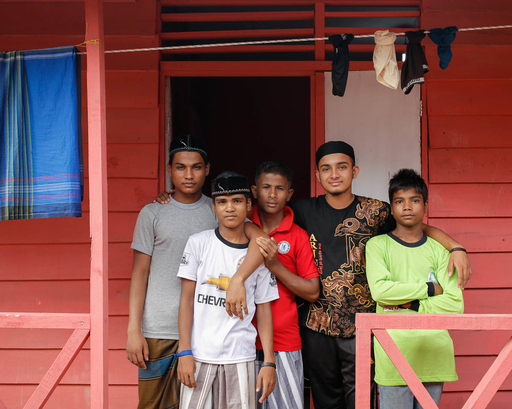 Hasson and his new, temporary family at the refugee shelter in Langsa, Indonesia.