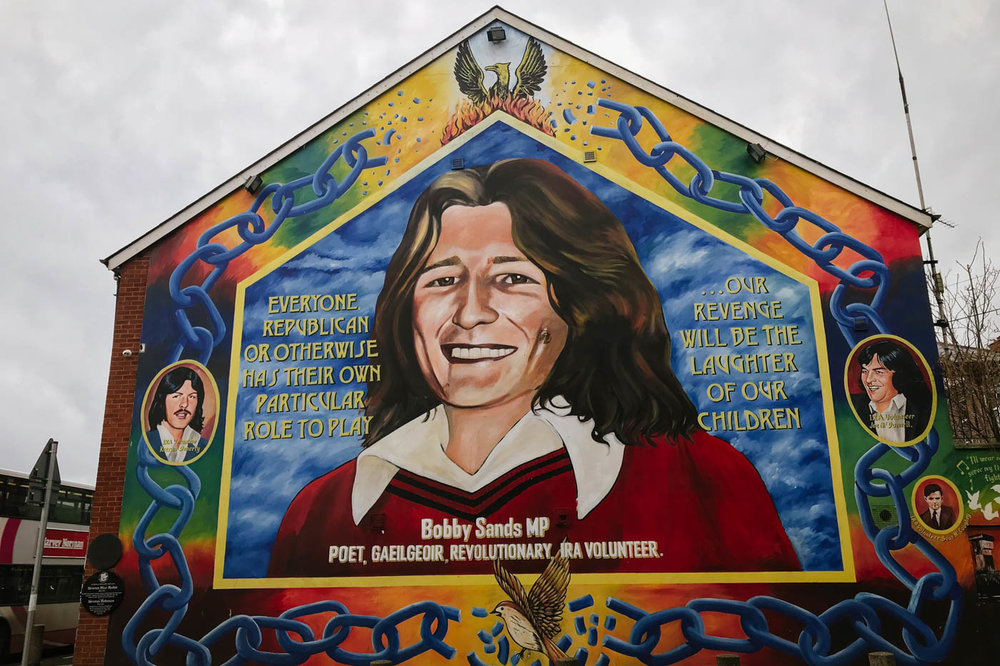 On Falls Road, a mural of Bobby Sands, the IRA hunger striker portrayed by Michael Fassbender in  Hunger
