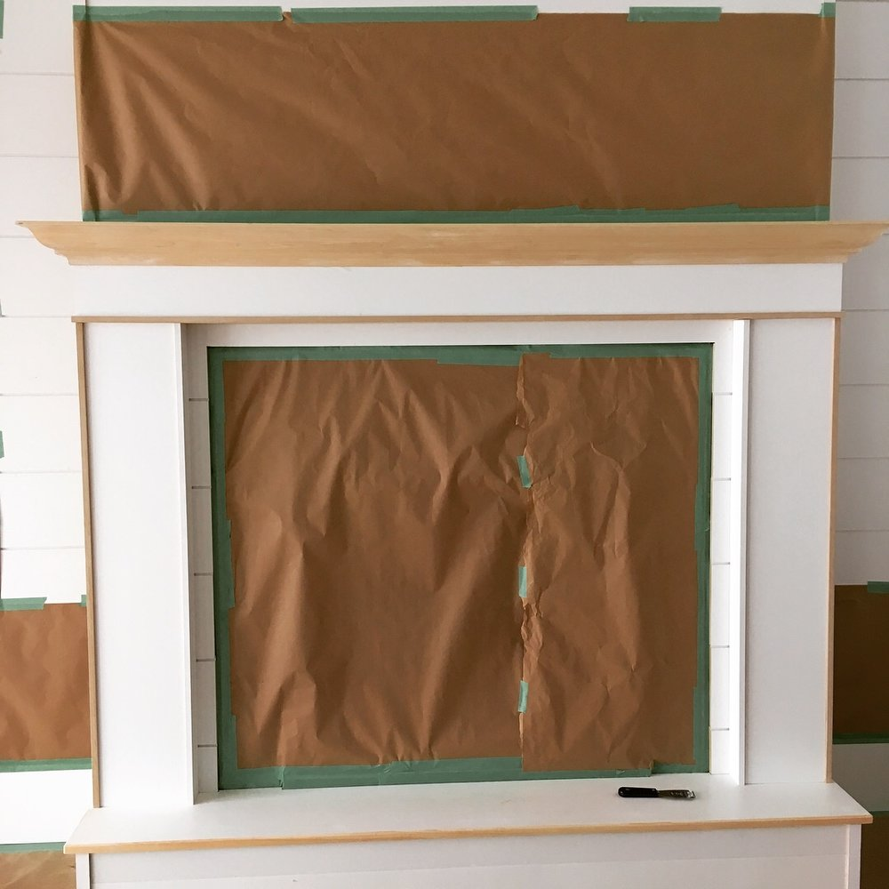 Here is a Lake Muskoka Fire place that shows how we carefully tape and paper off in order to get the perfect finish on the desired locations.