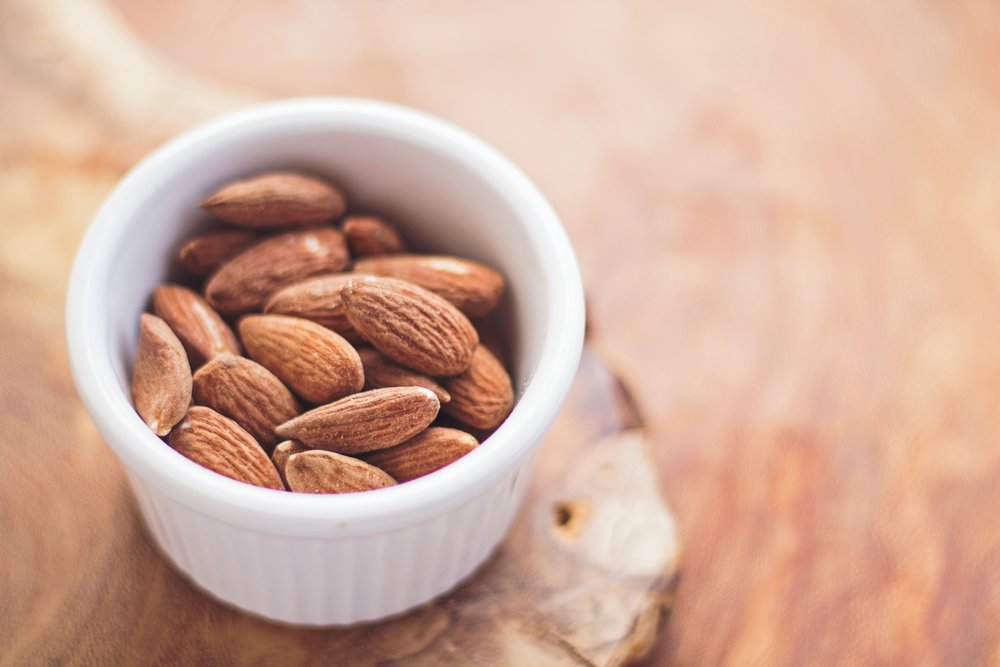 Don't be fooled—nuts are not a good source of protein. Yes, 100 grams of  almonds  has 21 grams of protein but 49 grams of fat.