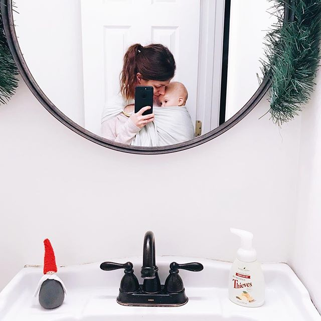 Our half bath got a new wall color, new mirror (overstock!) and the Christmas decor is making it feel all sorts of cozy. Slowly making this house our home and I'm so excited about the fact that the girls get to grow up here. Swipe to see a before.